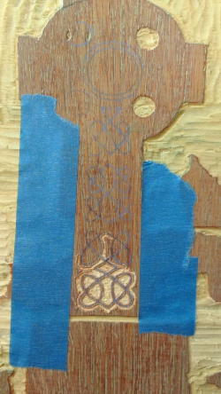 Using transfer paper, I transferred the details of the cross onto the wood. The quality of the wood and the size required me to use a dremel tool.